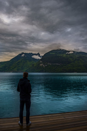 Beauty In Nature Cloud - Sky Idyllic Lake Leisure Activity Lifestyles Looking At View Mountain Mountain Range Nature Non-urban Scene One Person Outdoors Real People Rear View Scenics - Nature Sky Standing Tranquil Scene Tranquility Water