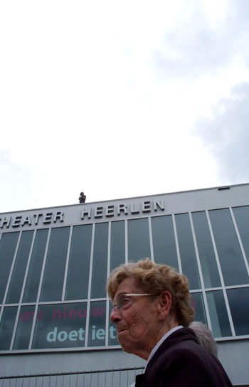 Low Angle View Of Person Outside Modern Building