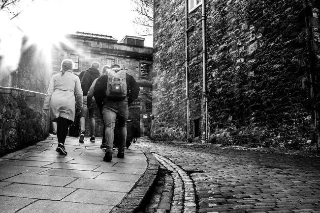 Scotland Edinburgh Blackandwhite Monochrome Nikon Nikonphotography D750 Nikond750 Streetphotography Street Cityscape City Tree Spraying Togetherness Men Full Length Standing Sunlight Sidewalk Building Exterior Cobblestone Street Street Scene City Street Road Marking Cobbled Building Residential Structure