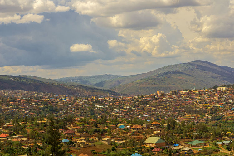 View to a part of Kigali in Rwanda Kigali Rwanda Africa Architecture Beauty In Nature Building Exterior Built Structure Cloud - Sky Day Landscape Mountain Mountain Range Nature No People Outdoors Scenics Sky Town Tranquility Tree