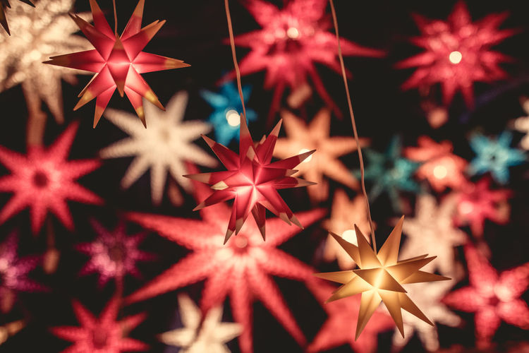 Backgrounds Black Background Celebration Christmas Christmas Decoration Christmas Lights Christmas Ornament Christmas Tree Close-up Glitter Holiday - Event Illuminated Indoors  Night No People Red Shiny Snowflake Star Shape Tree Topper