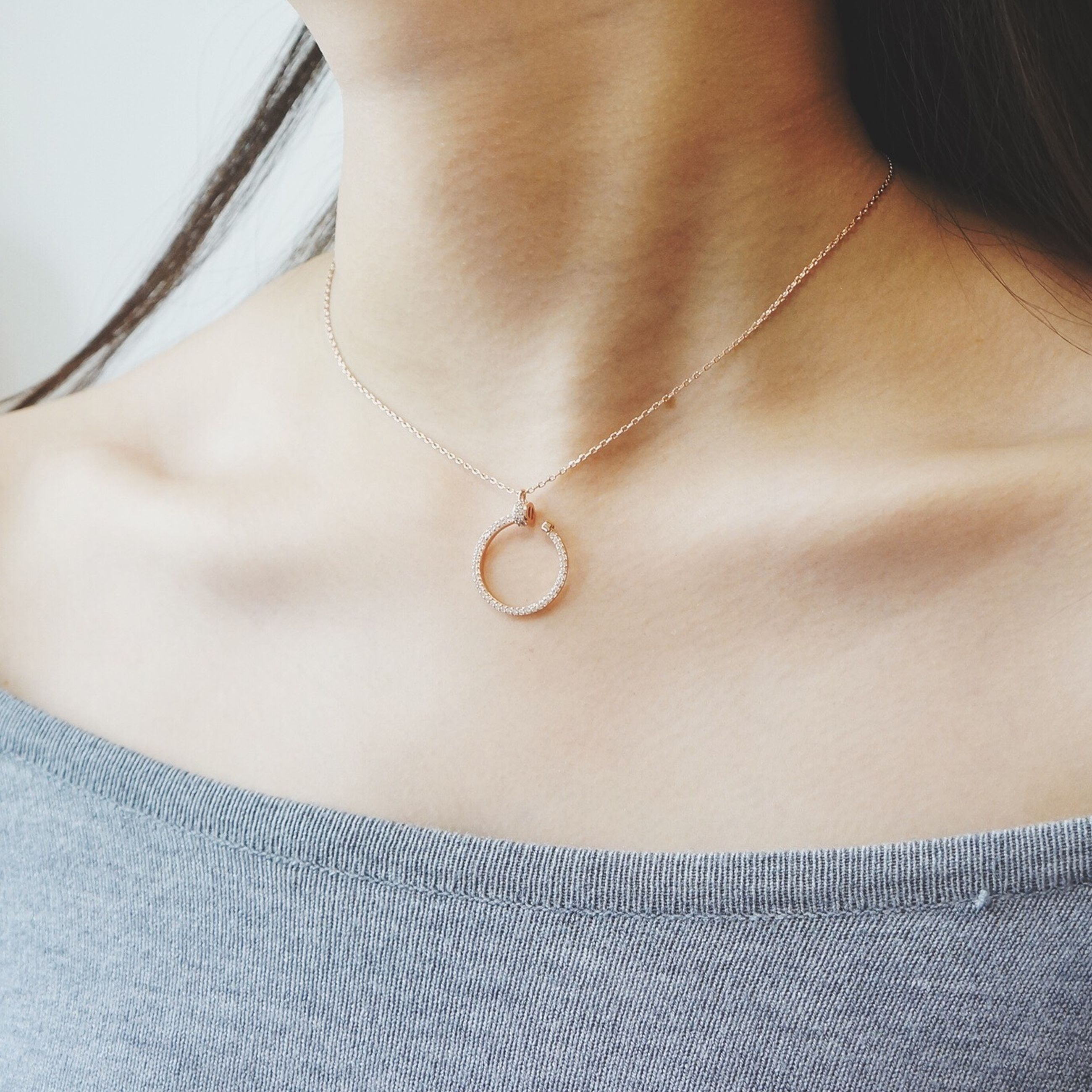 indoors, necklace, person, pendant