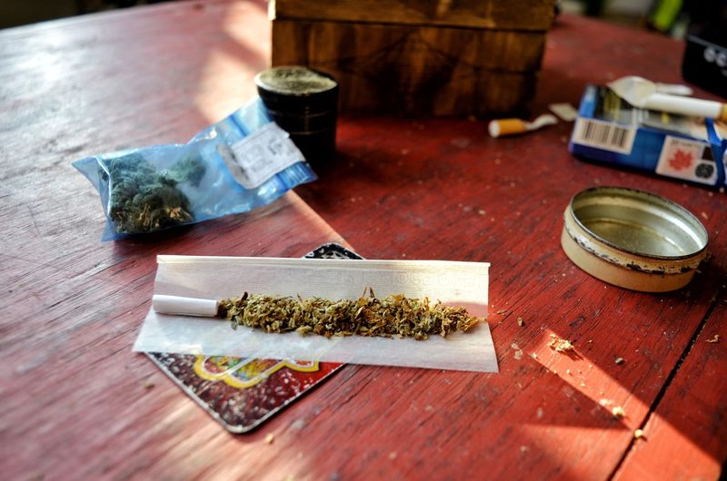 Table Wood - Material Marijuana - Herbal Cannabis Narcotic Social Issues Recreational Drug Indoors  Currency Cannabis - Narcotic No People Still Life Brush Food And Drink Focus On Foreground Cigarette  Art And Craft Paintbrush Paper Currency