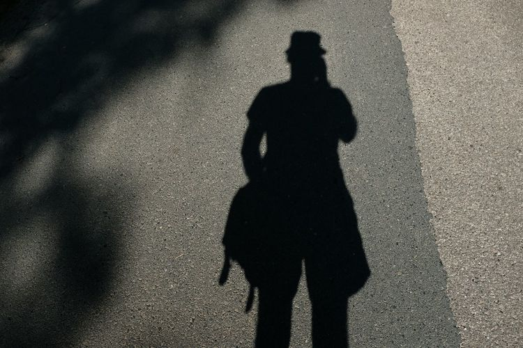 High angle view of person shadow on street