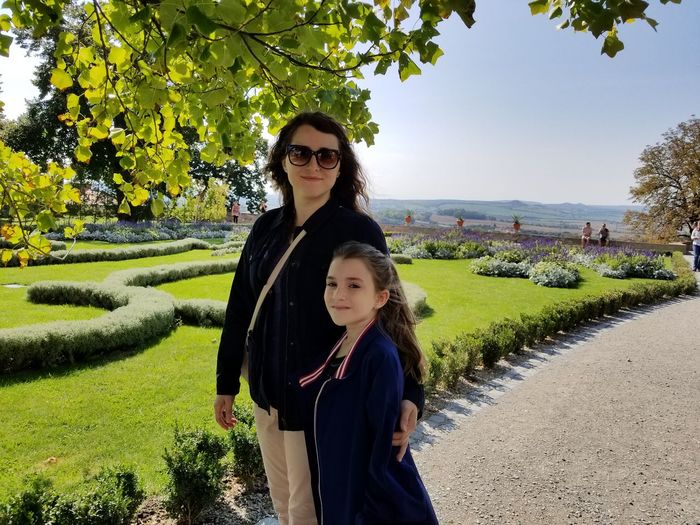 Portrait Of Mother And Daughter Standing In Park