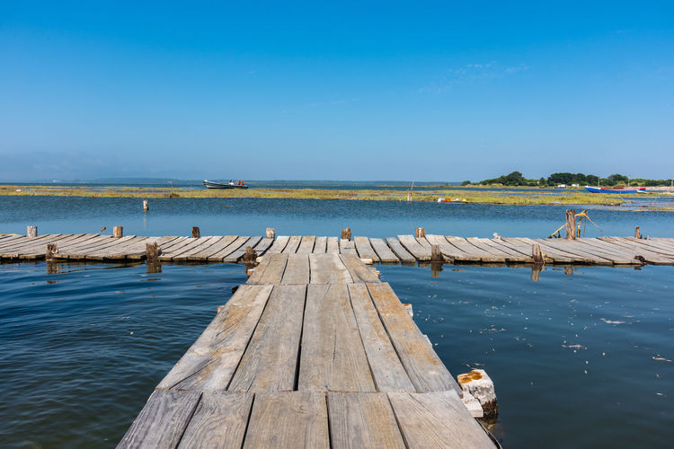 Harbour Portugal Rio Alentejo Beauty In Nature Blue Cais Day Dock Horizon Over Water Nature No People Outdoors Palafitic Palafitico Pier River Riverscape Riviere Sado Scenics Sky Tranquility Water Wooden Structure