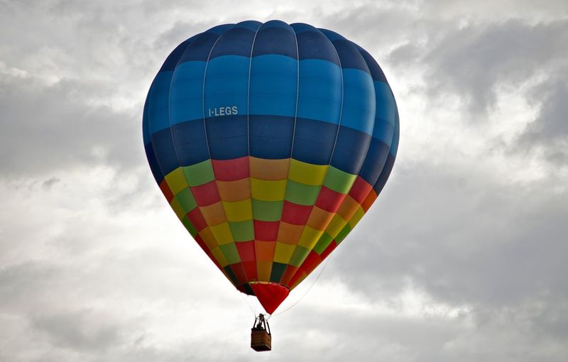 Color shape in grey clouds Adventure Air Vehicle Ballooning Festival Cloud - Sky Day Flying Hot Air Balloon Low Angle View Mid-air Multi Colored Nature No People Outdoors Sky Transportation