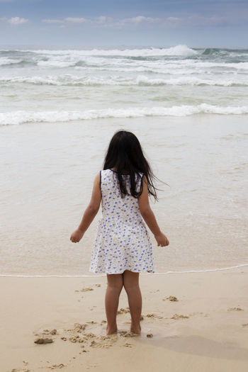 Rear View Of Girl On Beach