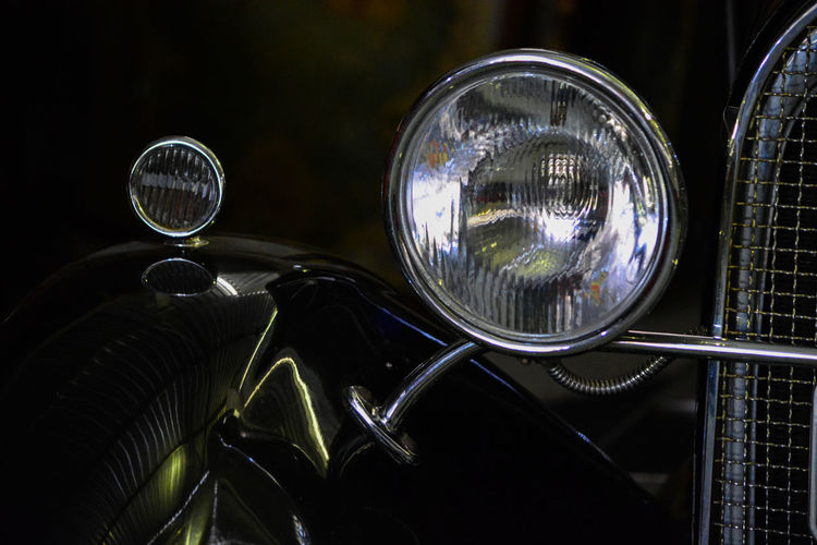 Close-up of vintage car against black background