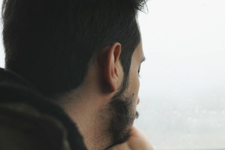 Close-up of bearded man outdoors