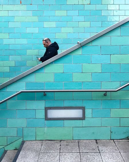 Man on steps in city
