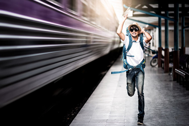 Traveler man running after a moving train from a railway station Delay Holiday Lifestyle Run Tourist Travel Arms Raised Arrive Backpacker Fast Late Lifestyles Miss Motion Movement Platform Quick Rail Railway Subway Sunglasses Train Train Station Transportation Vehicle The Traveler - 2018 EyeEm Awards