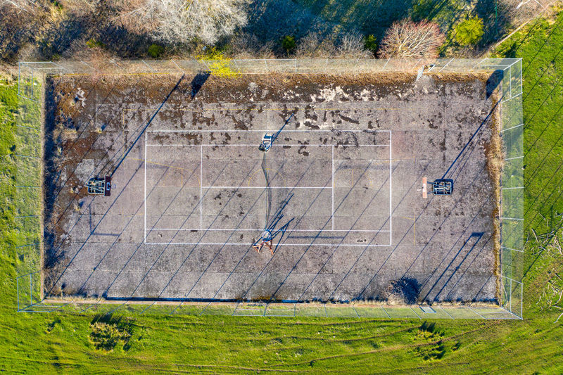 Housing Activity Engineering Structure Land View Sunset Outdoors Player Sport Development Built Healthy Court Game Up Recreational  Looking High Drone  Residential  Shadow Above Clay Racquet Life Community Aerial Angle Leisure Lifestyle Tennis Pattern Ball Pursuit  Exercise City Down Recreation  Scene