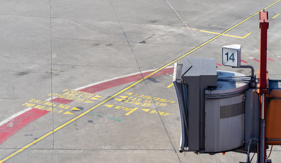 Airport Travel Traveling Business Finance And Industry Ramp Entrance Empty No People Communication Sign Number Symbol Outdoors Day Transportation Mode Of Transportation Public Transportation Public Transport Marking Paving Stone Road Marking Architecture High Angle View City Dock Boarding