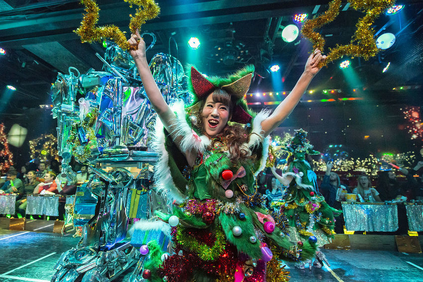 performance at the robot restaurant Arms Raised Celebration Cheerful Christmas Christmas Decoration Christmas Lights Christmas Tree Enjoyment Happiness Human Arm Illuminated Indoors  Indoors  Kabukicho Motion Multi Colored Music Neon Lights Night People Performance Robot Restaurant Smiling Stage Costume Women