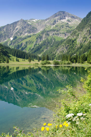 Lake Vilsalpsee in Tyrol Austria Austria Beauty In Nature Day Idyllic Lake Lake View Landscape Mountain Mountain Range Nature No People Outdoors Reflection Scenics Sky Standing Water Tranquil Scene Tranquility Tyrol Vilsalpsee Water