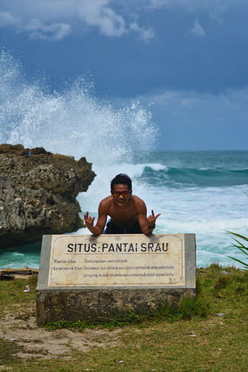 Tour on the Srau Beach. Pacitan, East Java, Indonesia Water Sea One Person Text Land Beach Motion Nature Western Script Portrait Young Adult Day Communication Solid Front View Headshot Wave Rock Teenager EyeEm Best Shots EyeEmNewHere EyeEm Selects Nature People Beauty In Nature