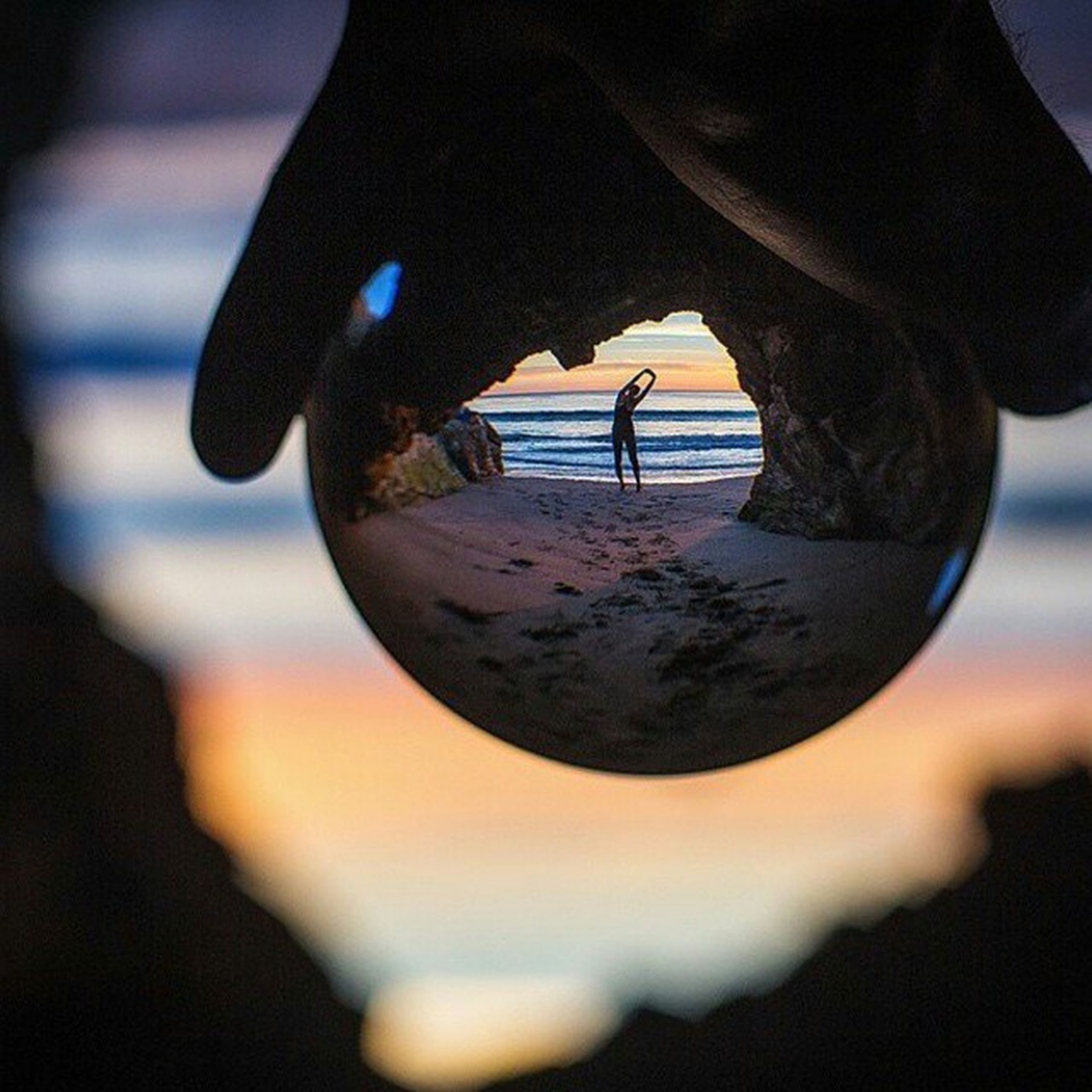 water, close-up, focus on foreground, reflection, lifestyles, part of, leisure activity, sky, person, unrecognizable person, selective focus, standing, holding, outdoors, cropped, nature, day
