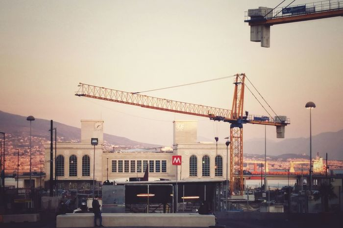 In attesa sempre Crane - Construction Machinery City Sky Harbor Commercial Dock Nautical Vessel Outdoors Architecture Cityscape Day Napoli ❤ Water Porto Sunset Architecture Art, Drawing, Creativity Travel Destinations Lines, Colors & Textures