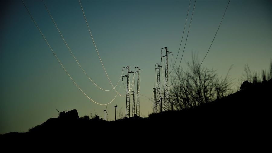 power twilight Beauty In Nature Cable Clear Sky Connection Day Electricity  Electricity Pylon Fuel And Power Generation Landscape Low Angle View Nature No People Outdoors Power Line  Power Supply Silhouette Sky Sunset Technology Telephone Line Tree Vapor Trail