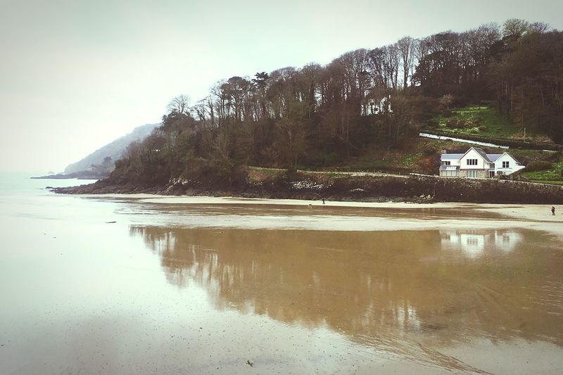 Water Nature Tranquility Lone House Sky Distant People Beauty In Nature Scenics Outdoors Day Beach Trees Soft Cloudy Misty White Sky Sea Nostalgic  Dreamy Melancholy White House Wet Sand Reflections Reflections In Wet Sand Headland EyeEmNewHere