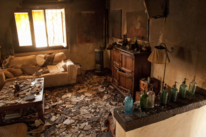 After The Fire Burned Damaged Architecture Architecture Burned Items Burned Objects Burned Stuff Damaged Damaged Building Damaged By Fire Damaged By Smoke Damaged Stuff Domestic Room Home Home Interior Large Group Of Objects Living Room Messy No People Sofa