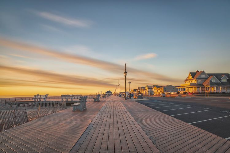 View of pier over sea against sky during sunset