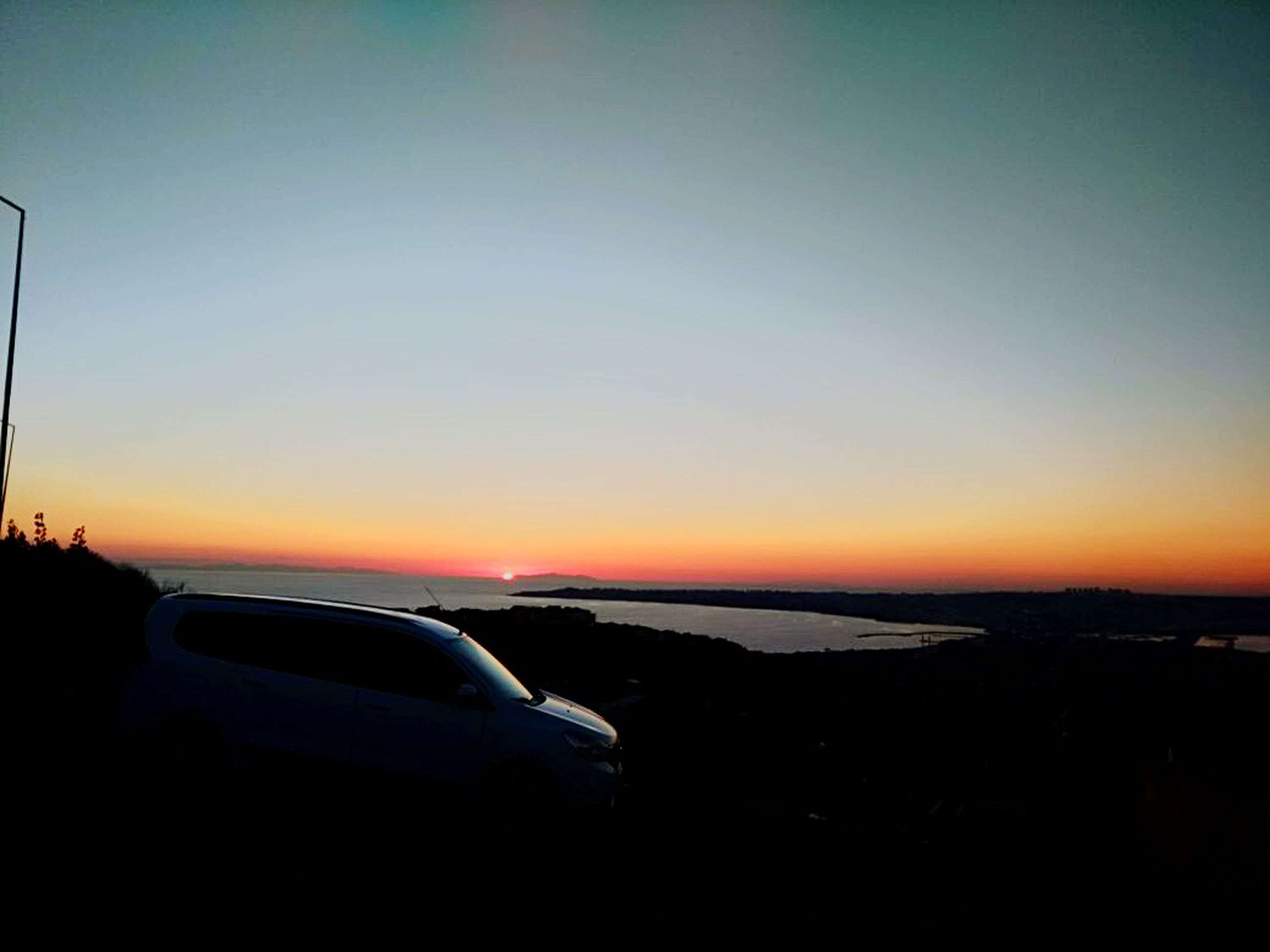 sunset, car, transportation, sea, sky, no people, scenics, land vehicle, nature, clear sky, landscape, beauty in nature, beach, outdoors, horizon over water
