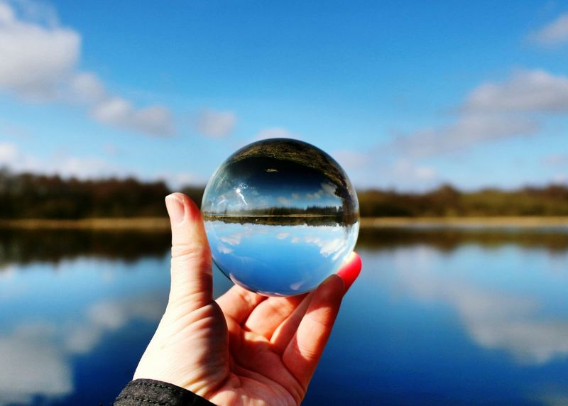 Sold On Getty Images Learn & Shoot: Balancing Elements Water Reflections Sunshine Bluesky Nature Scenery Tranquility Outdoors Non-urban Scene Hand Crystal Ball