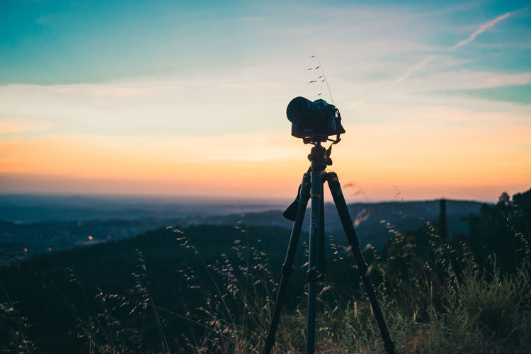 The Gear Sky Tripod Sunset Photography Themes Camera - Photographic Equipment Technology Scenics - Nature Field Photographic Equipment Beauty In Nature Land Landscape Cloud - Sky Camera Tranquil Scene Silhouette Non-urban Scene Nature Orange Color Tranquility Digital Camera No People Outdoors SLR Camera
