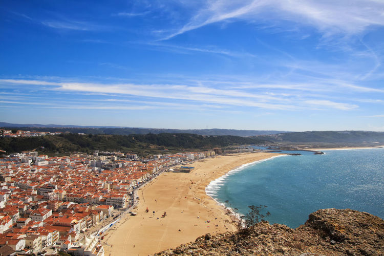 View from on top of the beach from Nazaré, Portugal Nazaré  Portugal Nazare Portugal Water Sky Sea Beach Beauty In Nature Blue Scenics - Nature Nature Day Tranquility Cloud - Sky High Angle View City Outdoors Cityscape Land Architecture Tranquil Scene Built Structure No People Landscape_Collection Landscape_photography