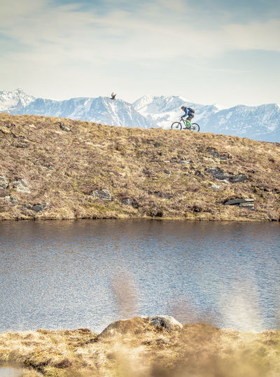 Beauty In Nature Cloud Cloud - Sky Cycling Day Eagle Idyllic Lake Landscape Mountain Mountain Range Mountainbiking Nature No People Non Urban Scene Non-urban Scene Norway Outdoors Physical Geography Remote Scenics Sky Snow Tranquil Scene Tranquility