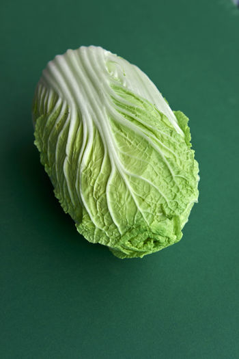 Chinakohl Chinese Cabbage Cabbage Close-up Colored Background Day Food Food And Drink Freshness Green Background Green Color Healthy Eating Indoors  Leaf No People Studio Shot Vegetable