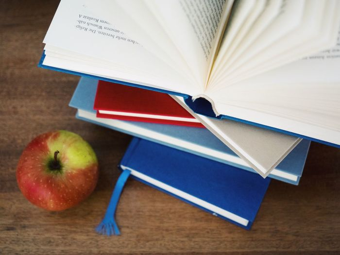 Apple - Fruit Book Publication Healthy Eating Fruit Education Food And Drink Indoors  Food Wellbeing Table Paper Learning Still Life High Angle View Note Pad No People Close-up Red Apple Studying Textbook Homework Study Time