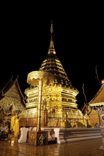 Golden stupa of Doi Suthep Temple! Architecture Building Exterior Built Structure Doi Suthep Temple Gold Colored Gold Everywhere You Look Golden Pagoda Golden Stupa Illuminated Low Angle View Night No People Outdoors Place Of Worship Religion Sculpture Sky Spirituality Statue Travel Destinations