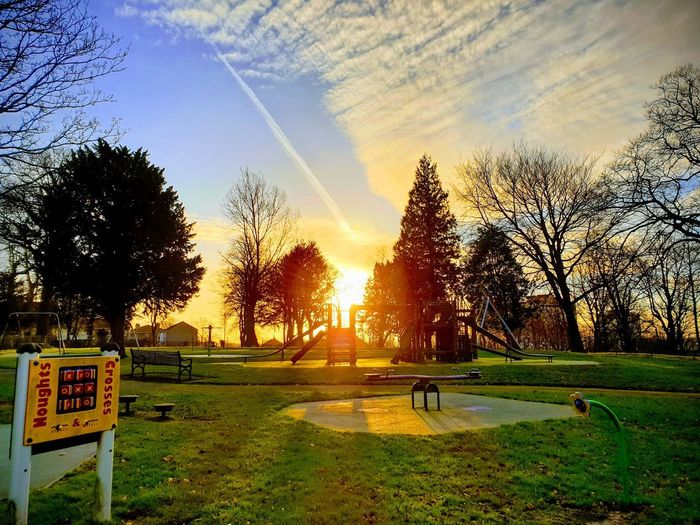 Scenic view of park against sky during sunset