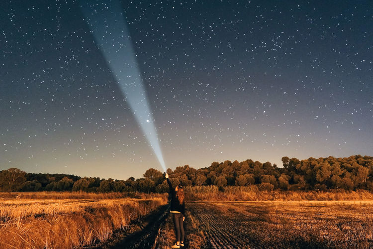 HUAWEI Photo Award: After Dark Lantern Lost In The Landscape Astronomy Beauty In Nature Clear Sky Constellation Field Galaxy Girl Landscape Nature Night Outdoors People And Places Scenics Sky Space Star - Space Starry Starry Night Starry Sky Tranquil Scene Young Woman Be. Ready. Capture Tomorrow