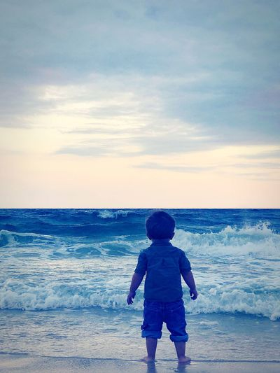 Stand Tall Child Sea Childhood Males  Beach Full Length Boys Sunset Water Sand Shore Tide Sandy Beach Coastline Ocean Wave Coast First Eyeem Photo