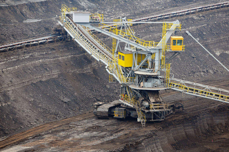 aerial view in coal mine with bucket wheel excavator. destruction of nature. fossil energy. Industry Mining High Angle View Fuel And Power Generation Coal Mine Quarry Coal Outdoors Transportation Tagebau Braunkohle Braunkohletagebau Fossil Energy Bucket Wheel Excavator Schaufelradbagger Environmental Damage Construction Industry Construction Machinery Fossil Fuel Machinery Equipment Above