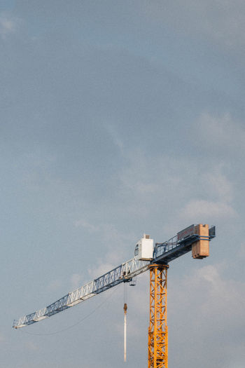 View of crane at construction site against sky