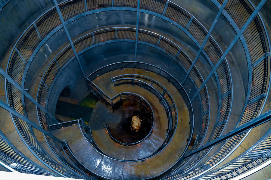 Eye of the Abyss full size Circle Abyss Waitomo Caves Waitomo EyeEmNewHere Eyeemphotography Spiral Staircase City Concentric Illuminated Futuristic Curve Modern Spiral Steps And Staircases Steps Geometric Shape Architectural Feature Architectural Detail Spiral Stairs Directly Below The Traveler - 2018 EyeEm Awards