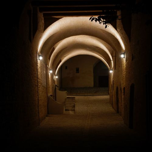 Arch Architecture Indoors  Built Structure The Way Forward Illuminated History Corridor Arched Narrow Long Historic No People Archway Diminishing Perspective Nightview Nightscape Eye4photography  Igersumbria Eye4photography  Ig_umbria EyeEmBestPics Volgoumbria EyeEm Gallery Old Town