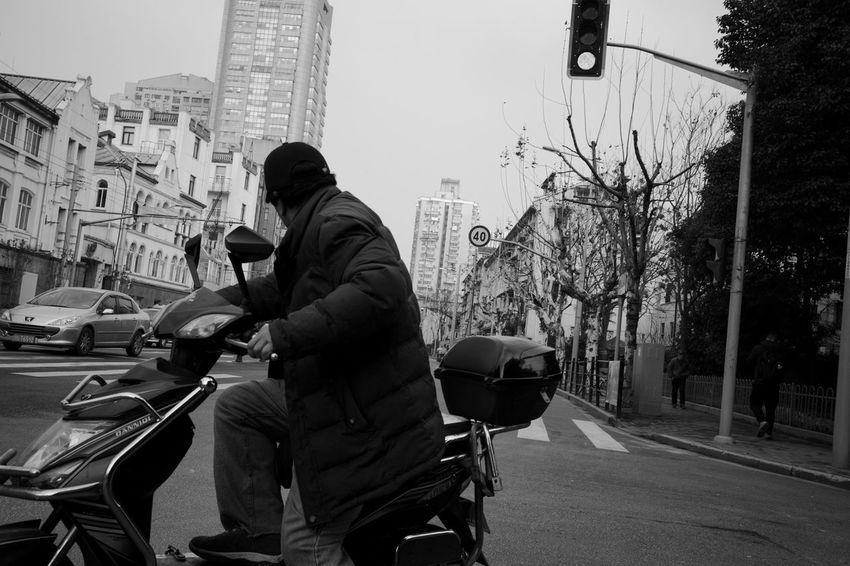 Street City One Person Transportation Real People Architecture Building Exterior Mode Of Transportation Land Vehicle Three Quarter Length Men Road Lifestyles Built Structure Day Car Motor Vehicle Holding Casual Clothing Riding City Street Outdoors Blackandwhite