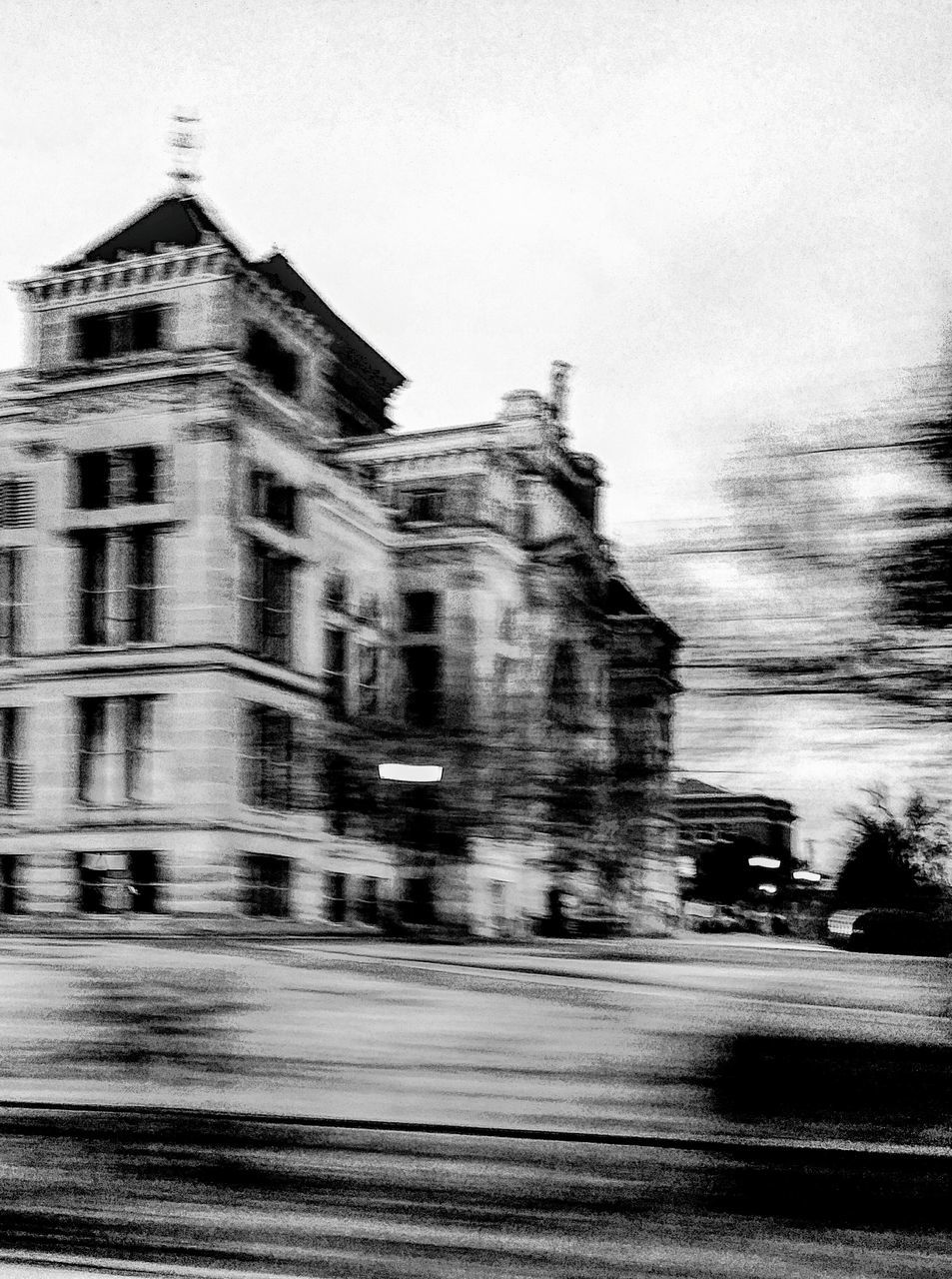 blurred motion, built structure, architecture, motion, building exterior, sky, speed, outdoors, no people, day, city
