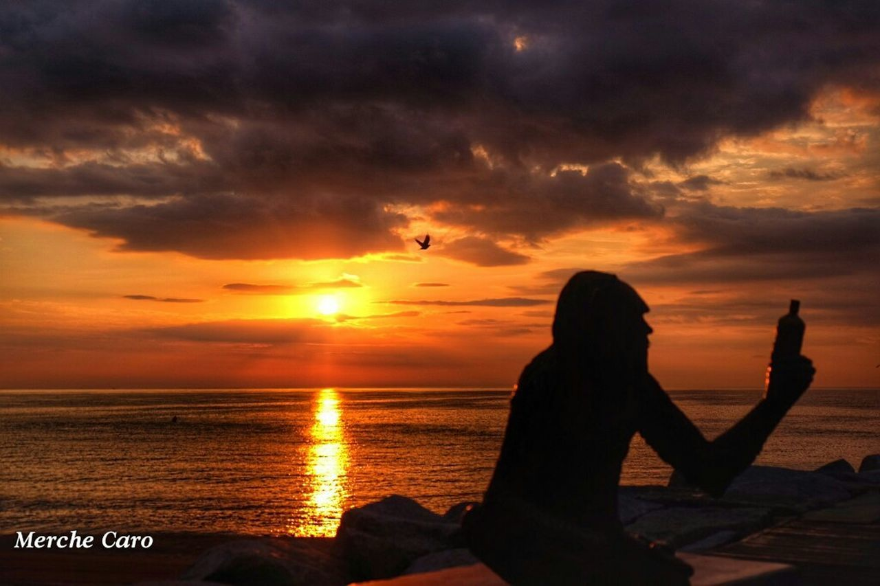 sunset, beauty in nature, nature, water, sky, silhouette, orange color, scenics, sea, sun, cloud - sky, idyllic, tranquil scene, tranquility, horizon over water, real people, leisure activity, lifestyles, women, outdoors, sitting, beach, men, people