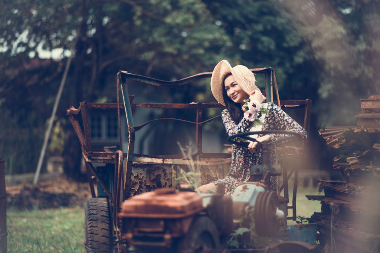One Person Happiness Plant Real People Smiling Women Young Adult Emotion Tree Selective Focus Adult Young Women Lifestyles Front View Nature Day Mode Of Transportation Casual Clothing Outdoors Beautiful Woman