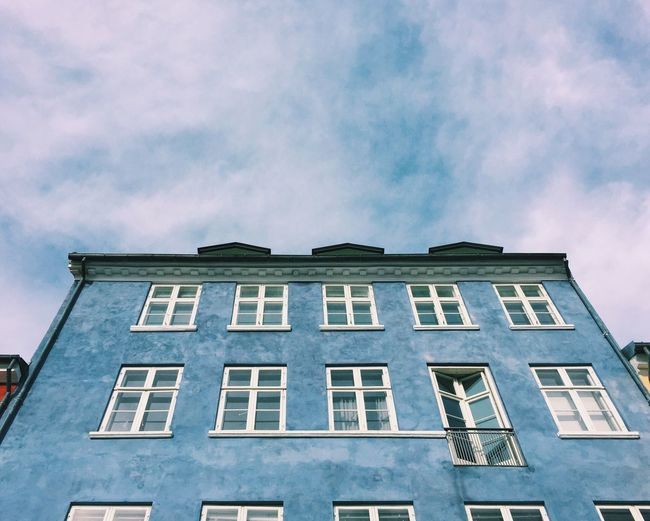 Built Structure Window Building Exterior Architecture Low Angle View Building Sky City Cloud - Sky Cloud Tall - High Day Cloudy Outdoors Apartment Office Building No People Blue Blue Sky Copenhagen Copenhagen, Denmark Nyhavn