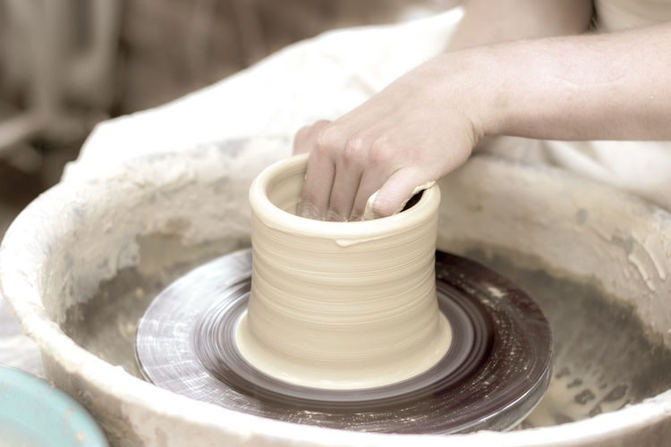 Human Hand Hand Skill  Pottery Art And Craft Working Craft Clay Spinning One Person Human Body Part Molding A Shape Making Expertise Creativity Motion Indoors  Occupation Real People Close-up Preparation  Body Part Finger Mud Human Limb