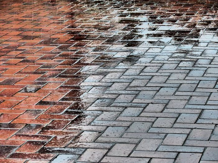 Pattern Full Frame Backgrounds No People High Angle View Architecture Street Footpath City Day Brick Textured  Outdoors Repetition Built Structure Building Exterior Close-up Stone Paving Stone Nature Tiled Floor Textured Effect Rainy Days Rainy Day
