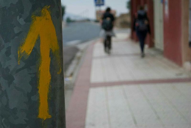 CaminodeSantiago Caminofrances El Camino De Santiago Camino De Santiago El Camino Arrow On The Road The Way Forward Camino Walking Walkoflife Friends ❤ Walk Walk This Way Arrow Symbol Arrows Yellowarrow